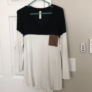 Black and cream tunic with suede pocket